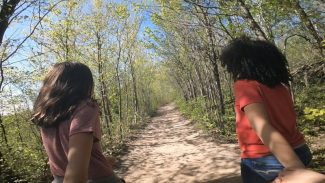 Family hiking - girls on trail