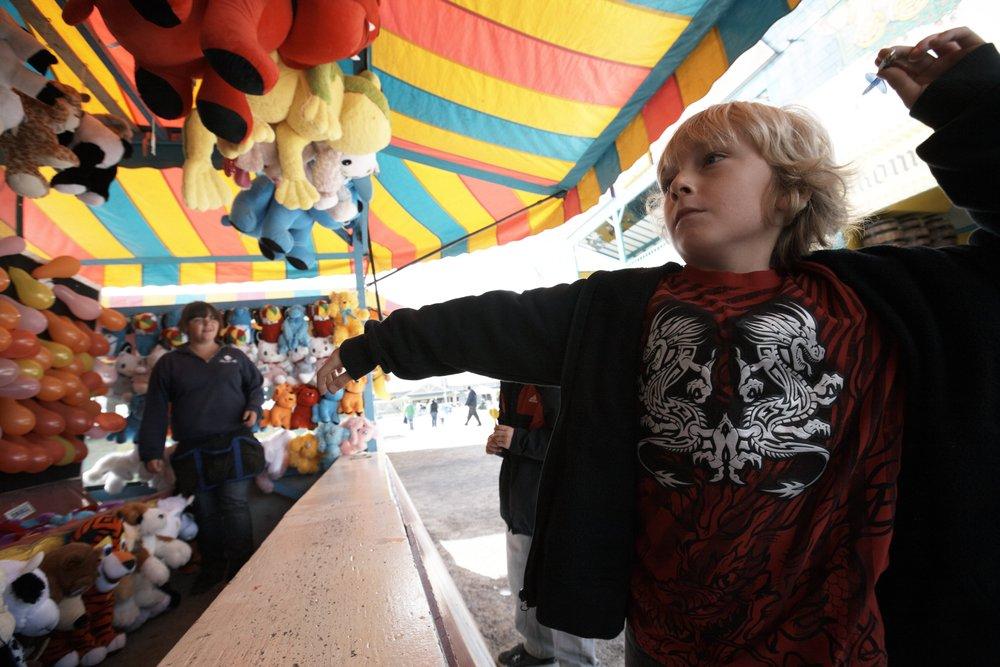 boy playing games at fair