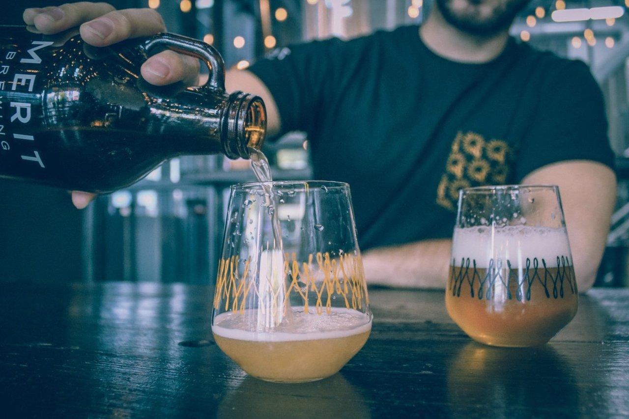 Man enjoying Merit beer