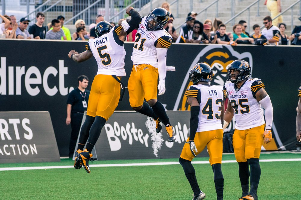 Ticats celebrating on the field