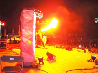 Fire eater entertaining crowd