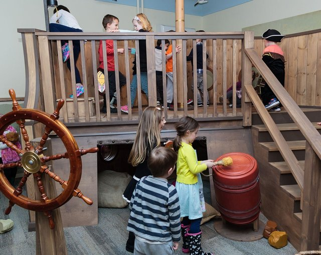Children playing inside museum