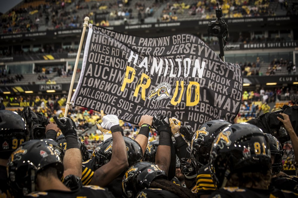 Hamilton Proud flag held by Ticats