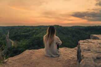 Girl sitting at Dundas Peak