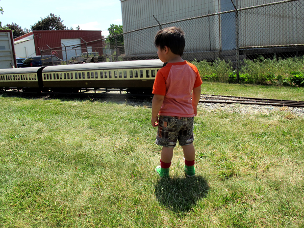Kid looking at train