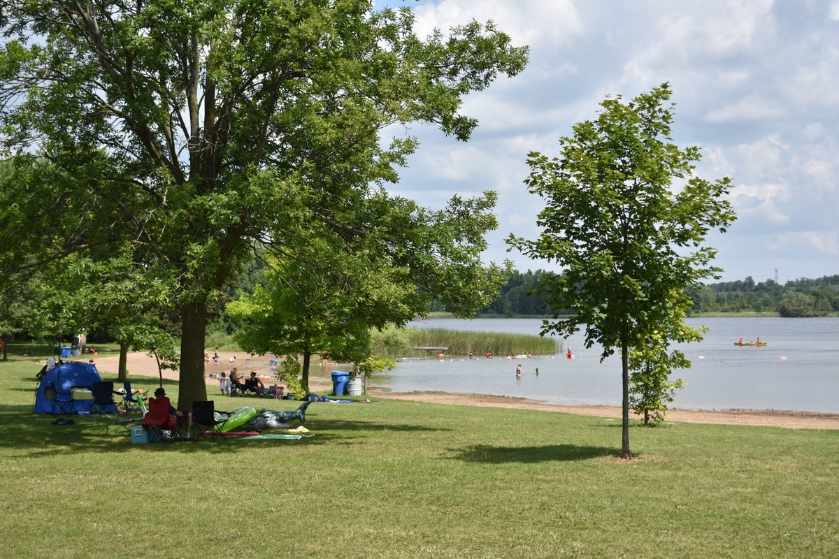 Valens Lake beachfront with visitors swimming