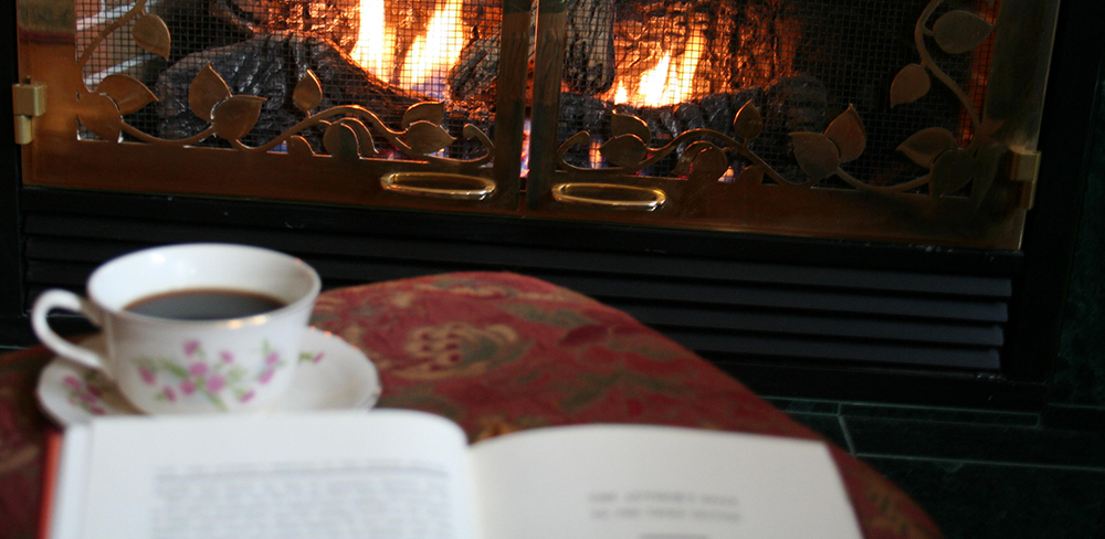 cozy book by fireplace