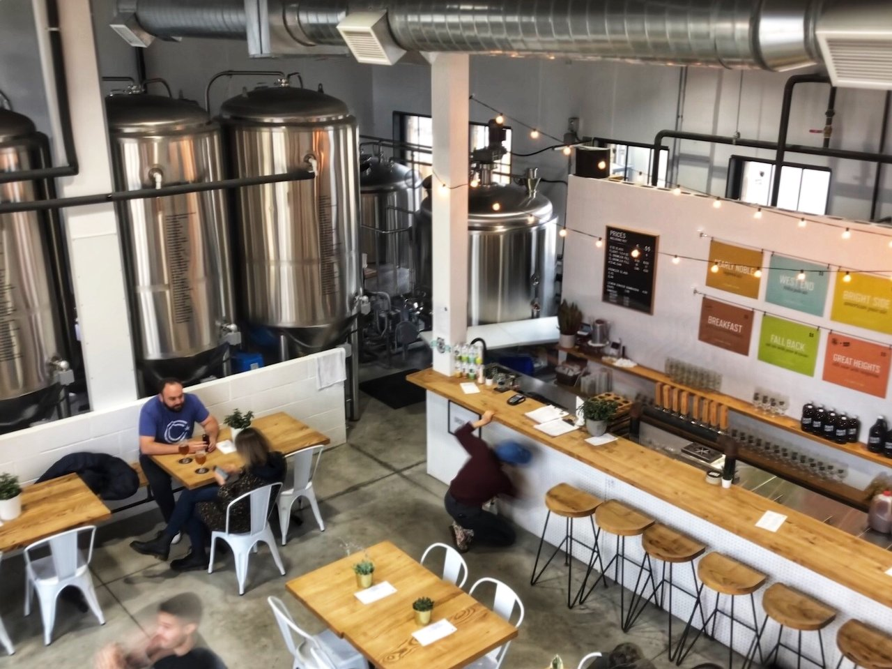 View of Grain & Grit tap room with tables and bar