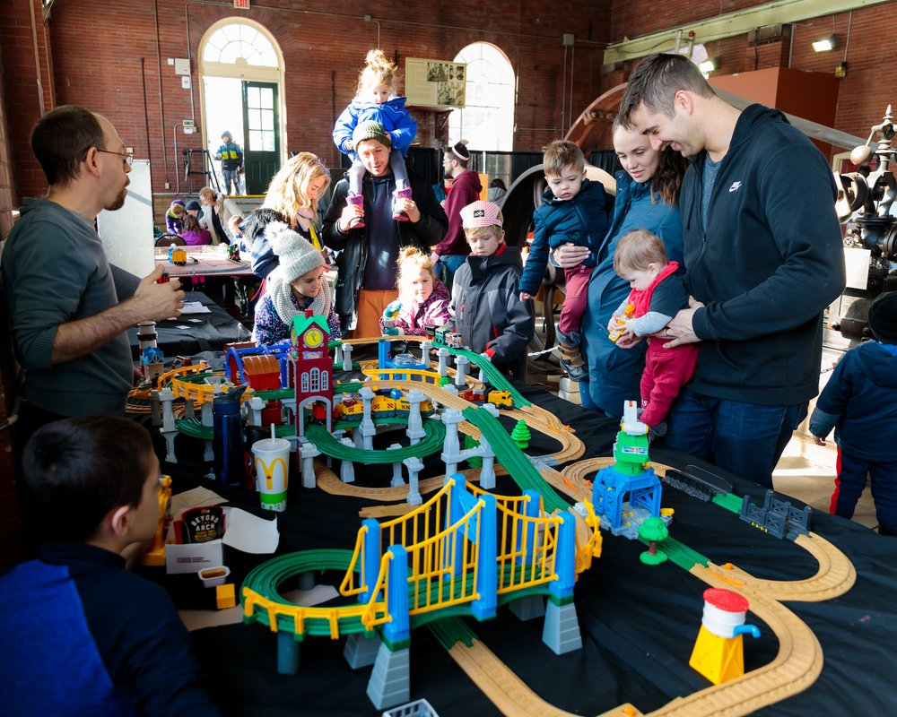Families enjoying train exhibits