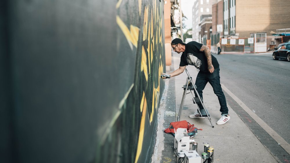 Painter creating mural