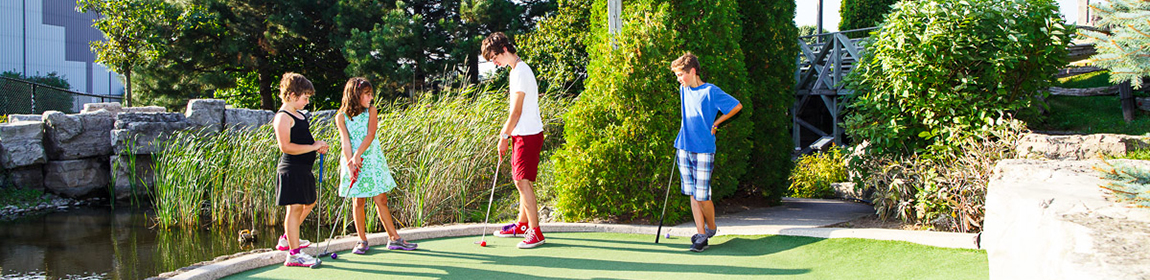 Kids playing mini-golf