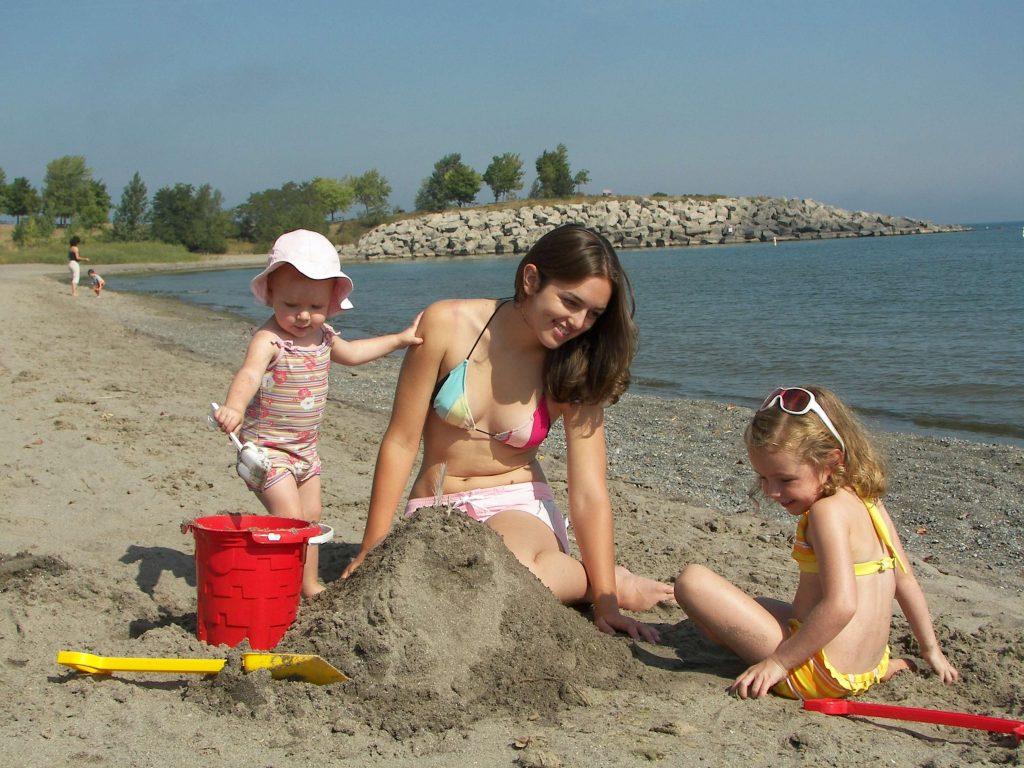 Young family playing in sand at 50 Point Conservation Area