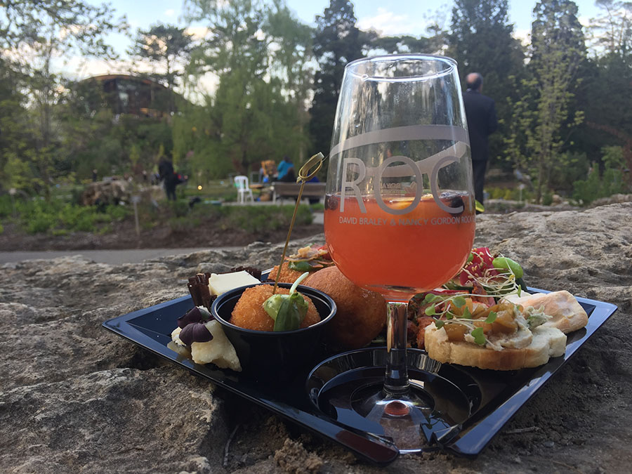 RBG event - close up of cocktail and appetizers with garden in background