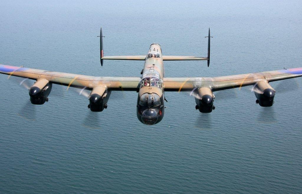 Canadian Warplane - Lancaster in flight over water